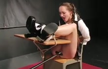 Pigtailed cutie spanked and machine fucked